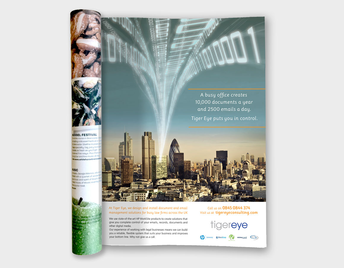 Magazine ad showing data pouring out of a skyscraper designed for Norwich based Tiger Eye by ad agency Greenwood&Bell