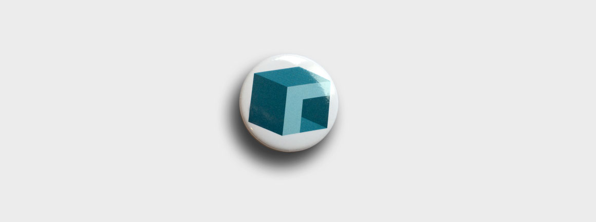 Ratiobox pin badge featuring Ratiobox logo designed by identity design specialists Greenwood&Bell based near Norwich